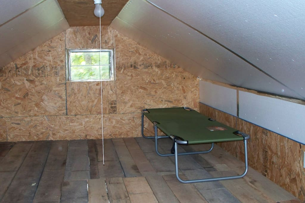 Loft area large enough to comfortably sleep 2-4 people on cots, mats, or air beds.