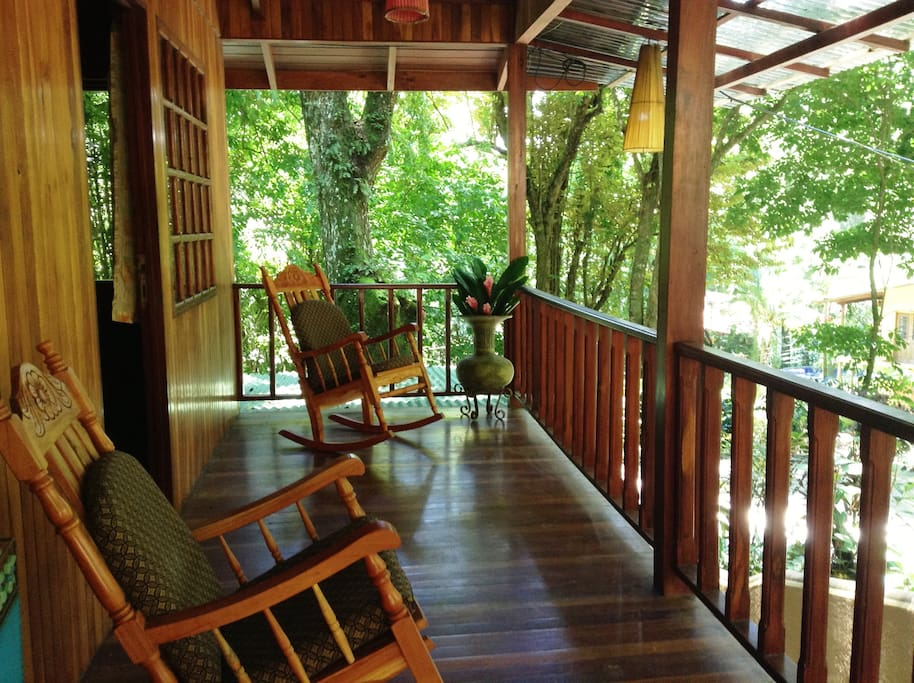 View the monkeys, birds, butterflies, etc. from comfortable rockers on the covered porch.
