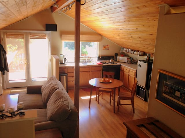 Kitchen and living room area. Through the doors/windows is the spectacular deck and views.