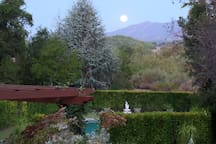View of the moonset over the mountains beyond the pool. This is a view from the deck.