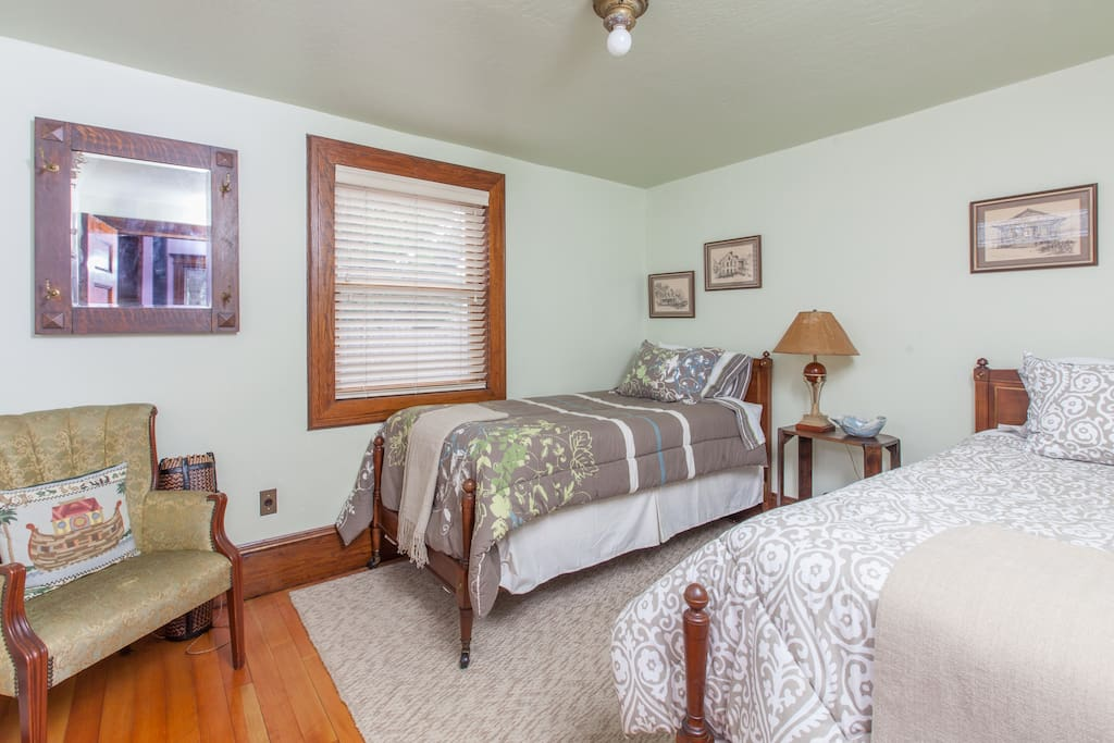 Downstairs bedroom at bridge cottage. Pair of twin beds