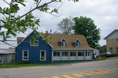 Blue house in front of a church - Les Bergeronnes