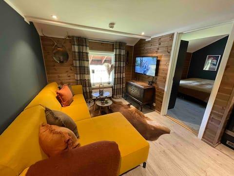 Krásny, novo zariadený apartmán so spálňou a loftom.