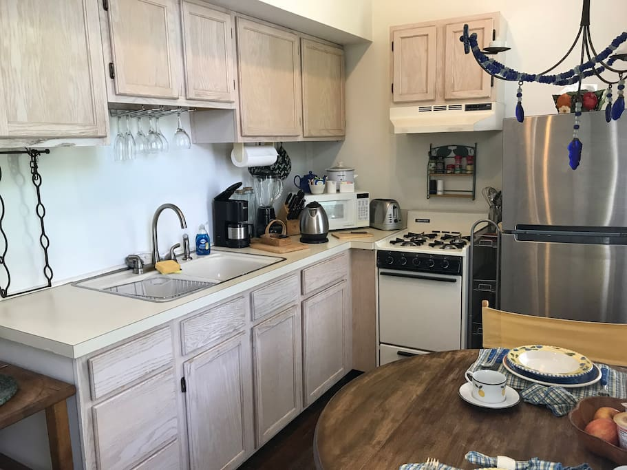 Eat-in Kitchen. Bright with 2 windows. Fully equipped with round drop leaf table. The kitchen has all  supplies.