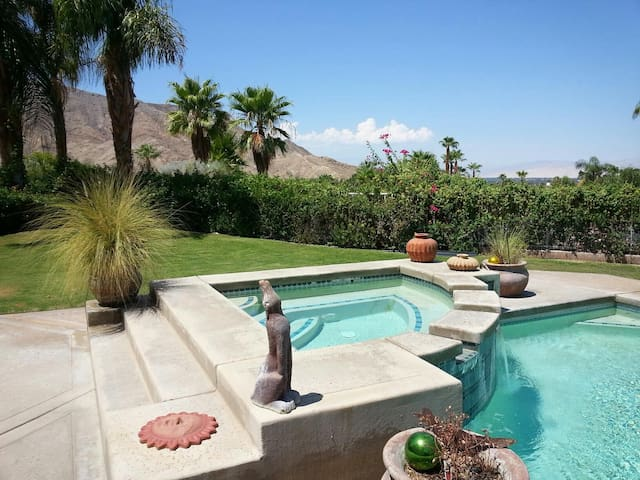 Hot tub and pool on property just steps from your room. Enjoy outdoor lounging and dining.