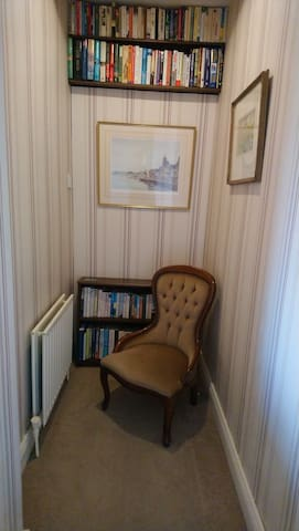 Browse through our books in the cosy reading nook.