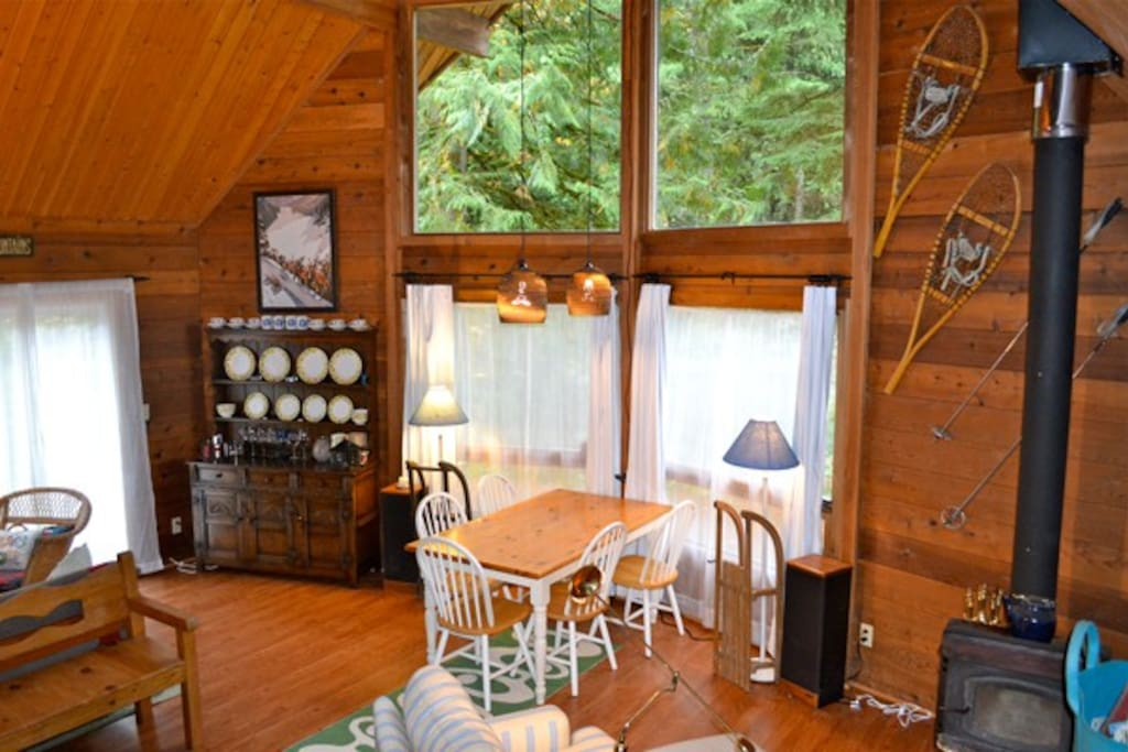 This is the main LR/DR/game room with wood stove and pretty views.  There is also a hideabed in this room with a double bed.
