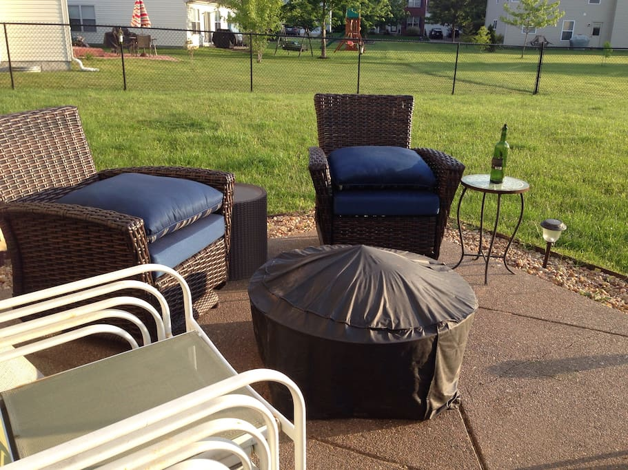 Patio also has round table and gas grill