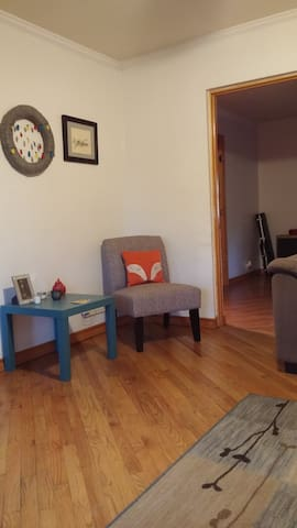 A cozy corner chair and end table is another sitting space in the living room.