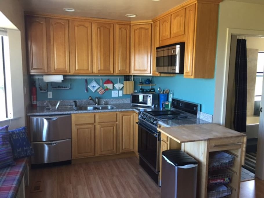 Full kitchen - Microwave, Oven, Toaster Oven, Dish Washer, Dishes, Glasses, Cutlery, etc.