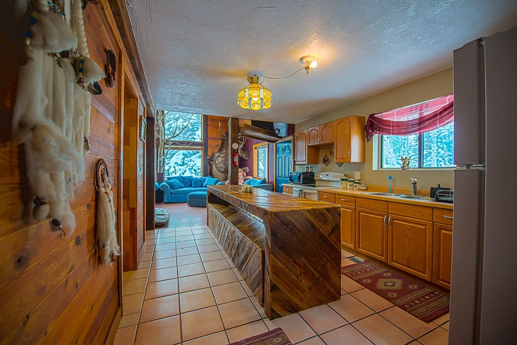 Full kitchen with tons of counter space plus large table!