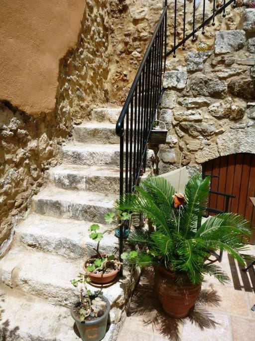 Stairs up from the courtyard.