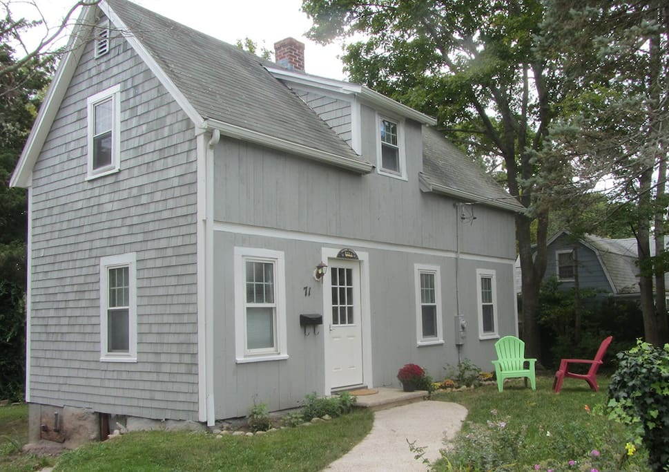 The welcome mat is out for you at this cozy home, newly painted Cape Cod gray.