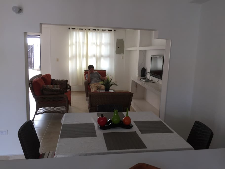 Living room with TV that guests have access to.