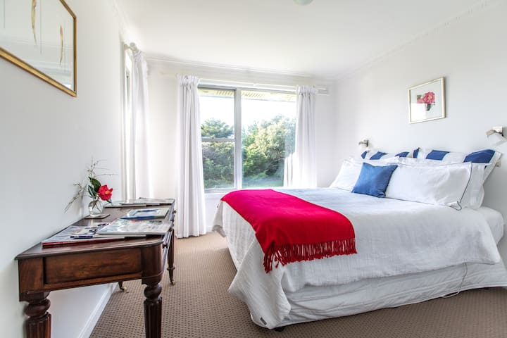 A queen-sized bedroom with luxury cotton bed linen