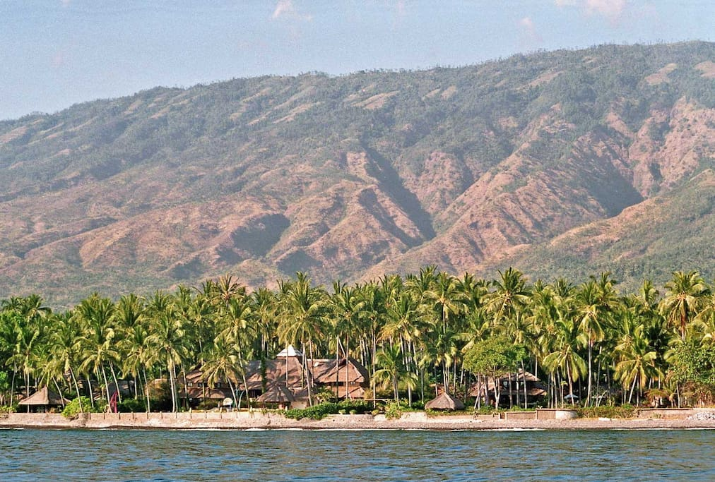 Villa Melamun (left) and Kura Kura (right) from the sea with the Batur caldera in the background