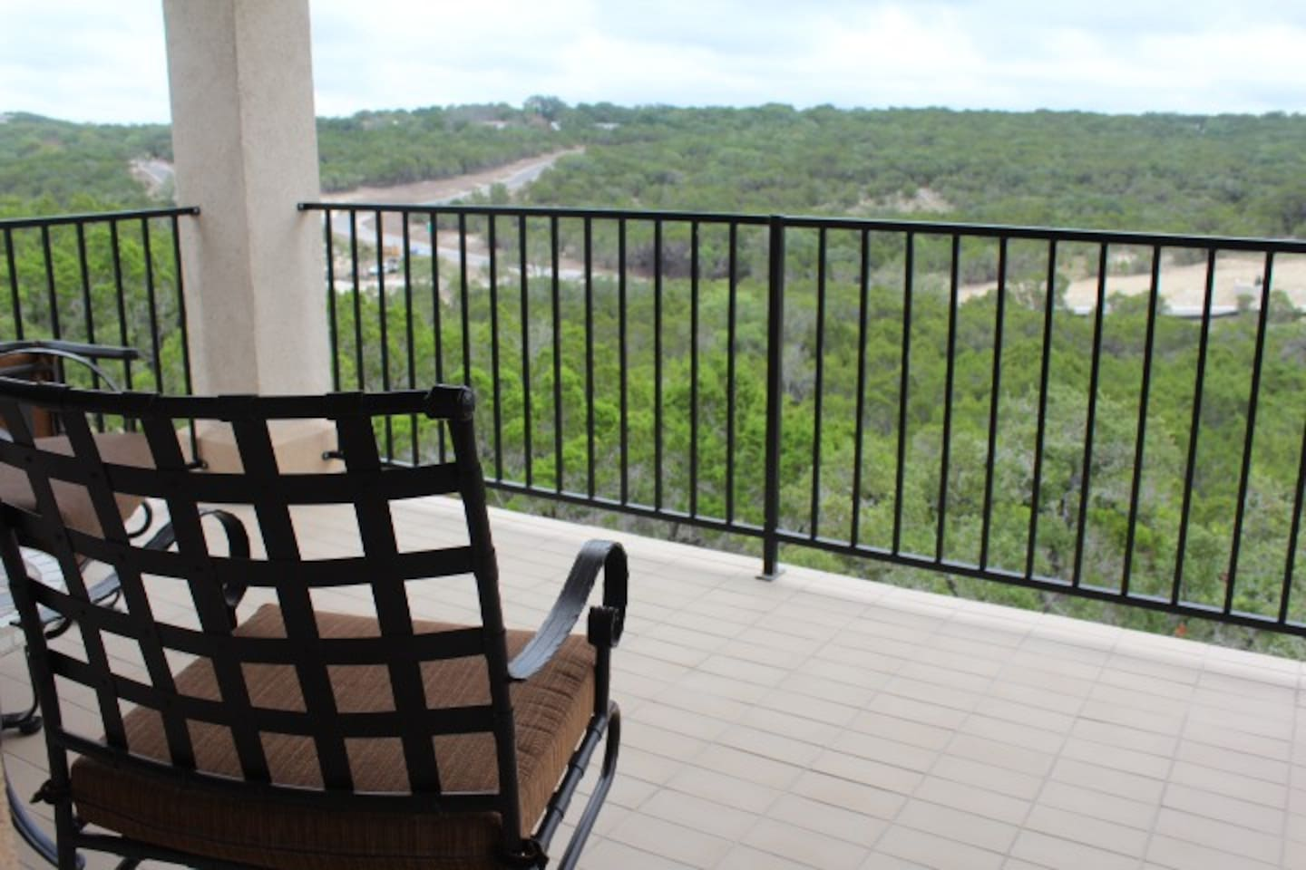 Relax in the balcony overlooking a nature preserve