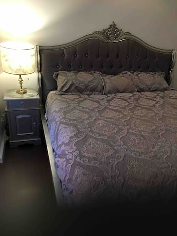 King size bed, separate from main living / kitchen.