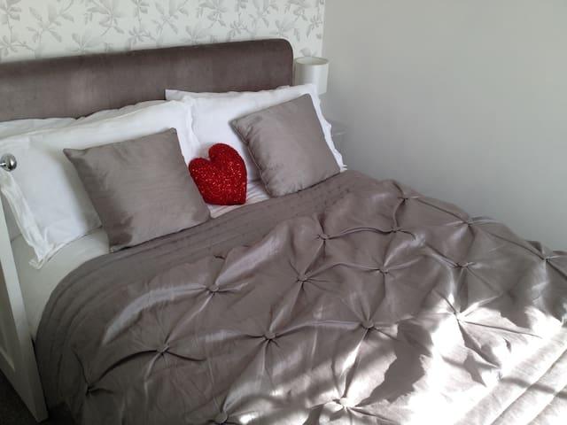 Romantic bedroom with silver velvet sleigh-bed