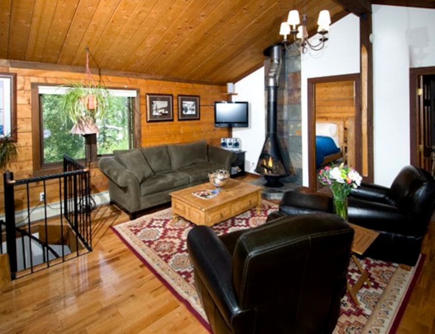 Upper living room with wood stove.