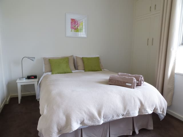 Bedroom has a large double bed and plenty of storage space in two big cupboards.