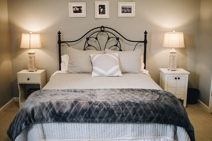 Master bedroom with wide access on both sides of queen bed.  Sleep peacefully on a plush 10 inch thick gel memory mattress!
