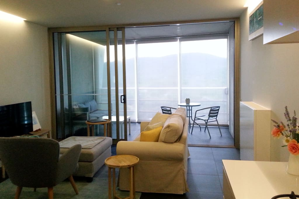 The lounge area extends into the balcony or can be closed off with sound-proofing double-glazed windows. The balcony has full-length block-out blinds.