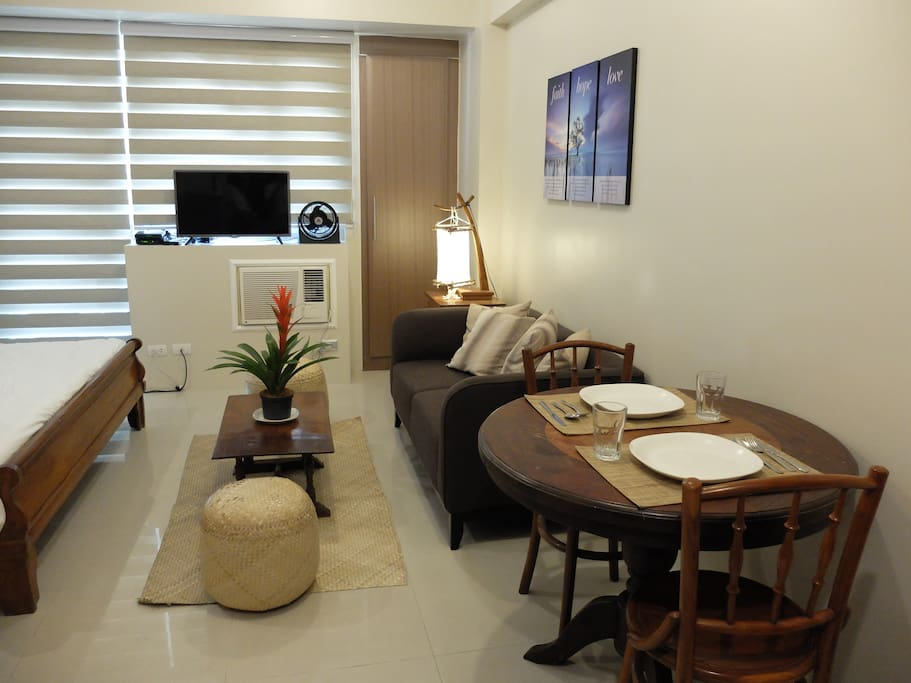Comfortable couch  and dining area with free wi-fi and cable tv.