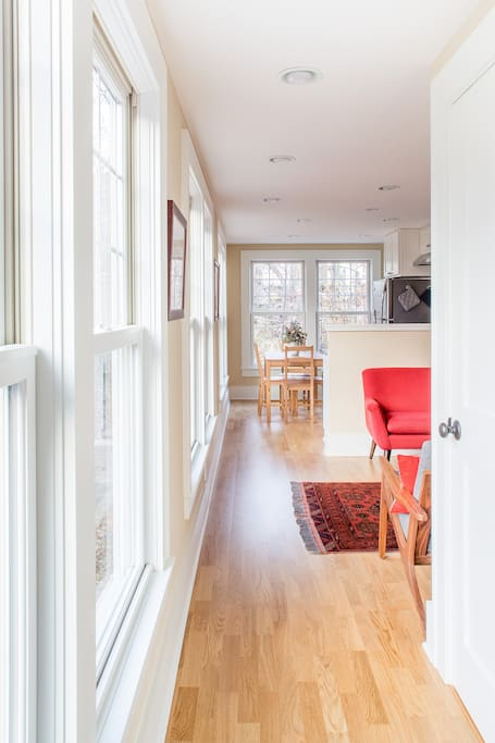 The entrance welcomes you into your cozy home away from home. Ample front hall closet for shoes and coats, heated floors throughout first floor, plenty of warm, natural light.