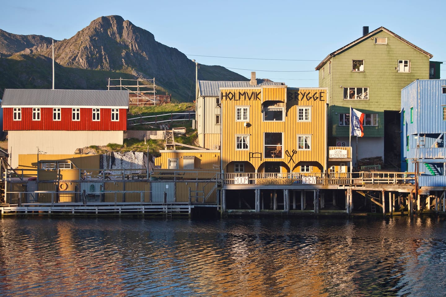 Welcome to Nyksund. The red building is our studio-apartmenthouse.