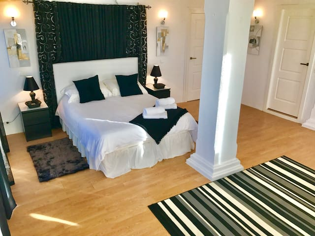 The master bedroom suite located on the first floor, with dressing room and bathroom, along with sea views across to Gibraltar and Africa.