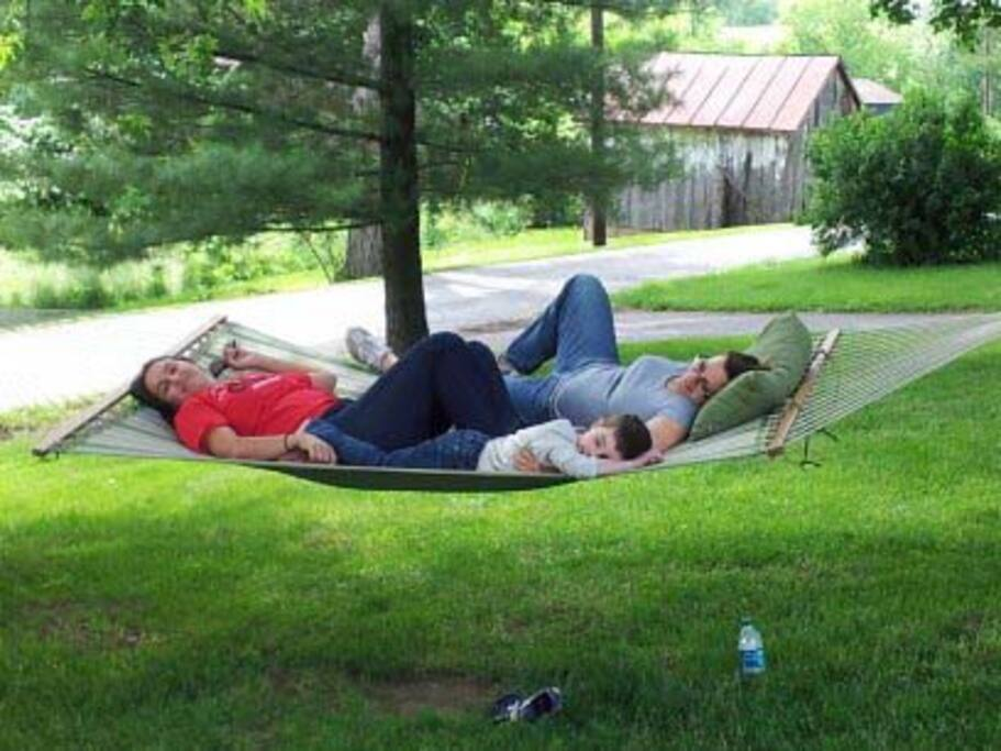The hammock is made for two and stretched under century-old maples at First Farm Inn bed and breakfast.