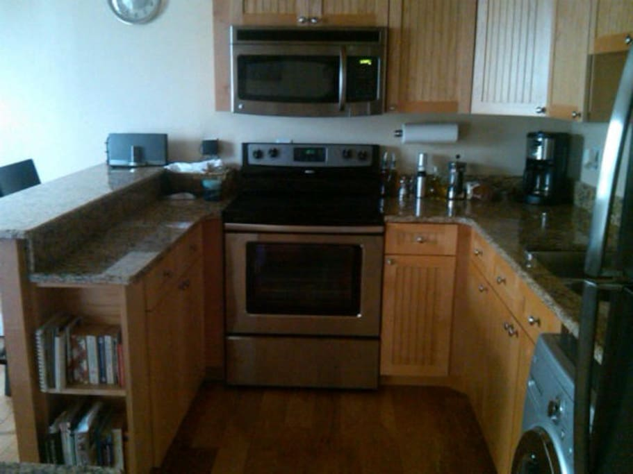 new stainless stove, microwave, coffee maker.