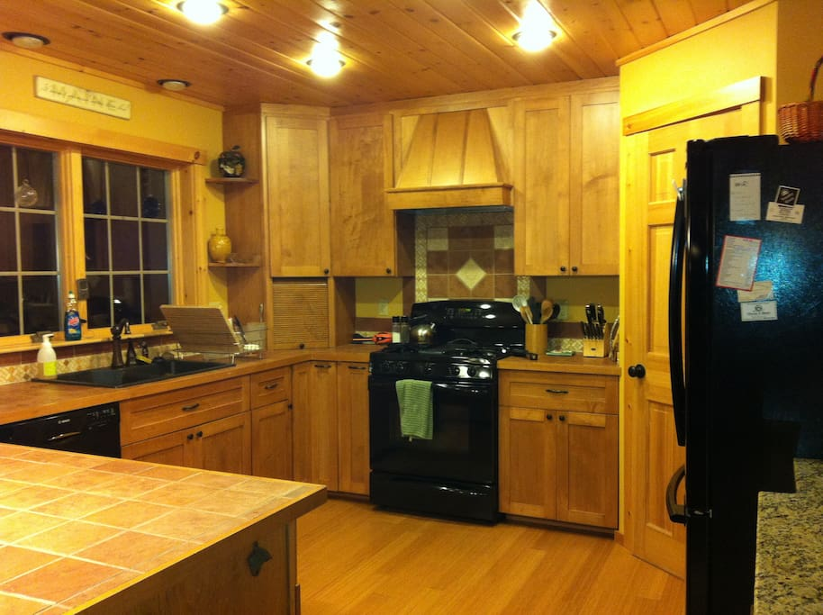 Kitchen w/ 5 burner stove, oven and warming drawer plus all the tools for you to make a wonderful, gourmet meal!