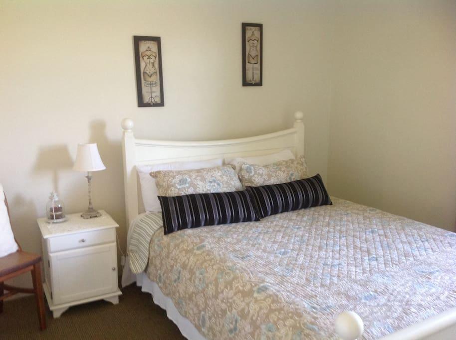 Queen bed, wardrobe, in the bedroom