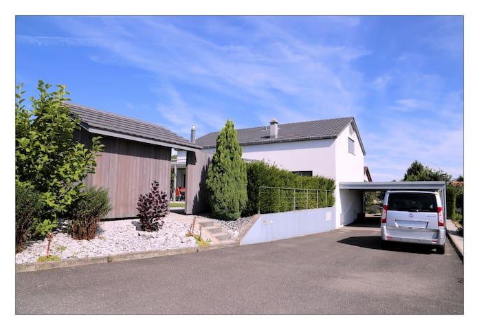 Spacieux studio (sans cuisine), 40m2 - Corjolens - 家庭式旅館