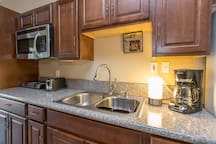 Fully stocked kitchen: stove-top, build in microwave/oven, hot and cold water dispenser, coffee maker, toaster, pots/pans, silverware, new plates, crystal glasses, etc..