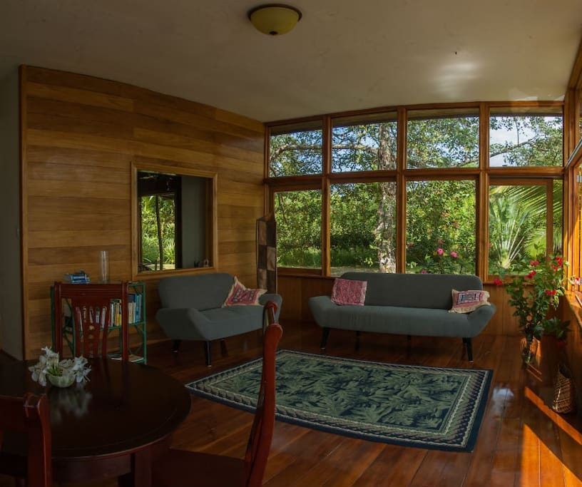 Large living area with large windows allowing in lights and the fantastic views.