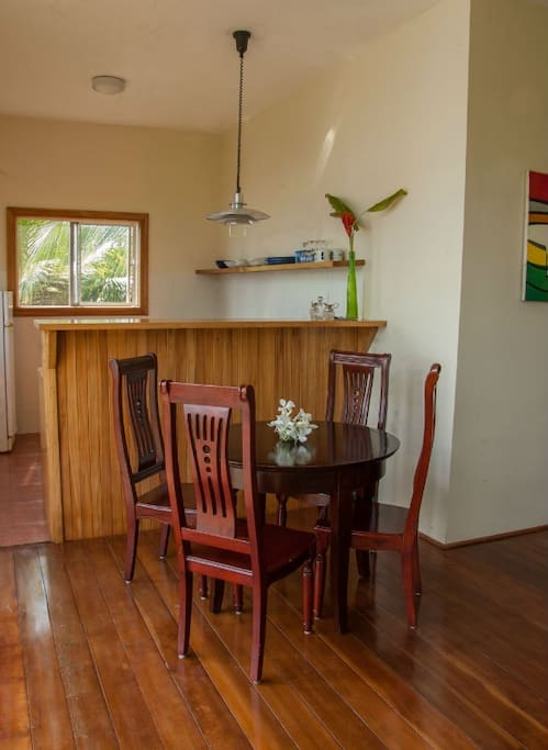 The Cottage kitchen with small dining table.  The kitchen is fully equipped and