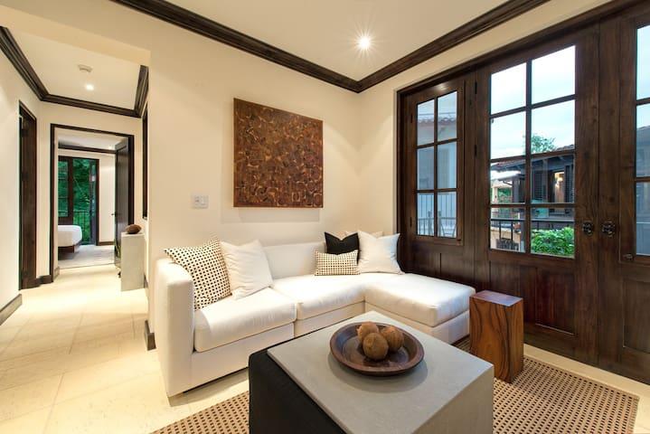 Living Space w/ folding doors leading to balcony
