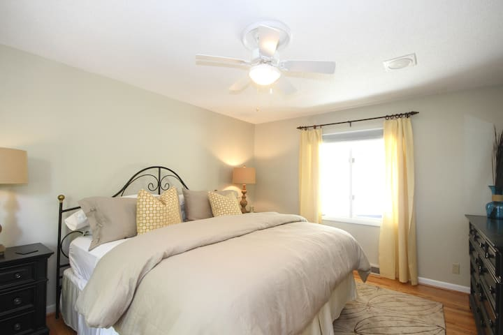 Beautiful, bright master bedroom with king size bed, comfortable 100% organic cotton Colton Mattress, TV, dresser, walk in closet with Turkish robes, master bath with double vanity and views.