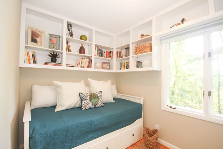 3rd bedroom with day bed which pulls out to a queen bed and closet with Turkish robes. This is a comfortable, cozy bedroom which shares a bathroom with the 2nd bedroom.