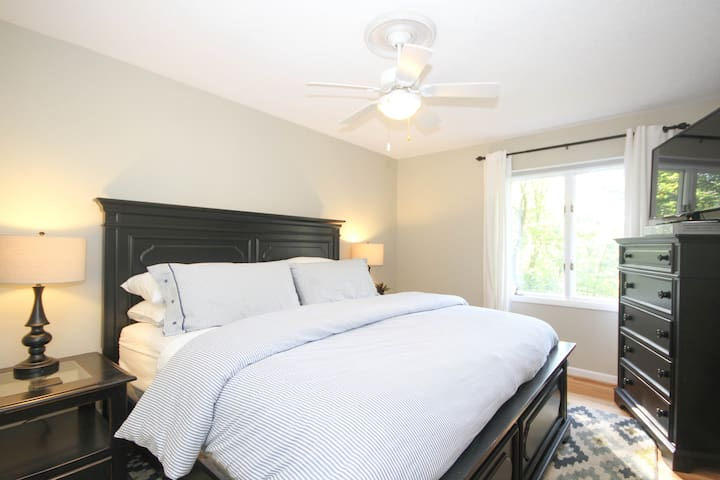 2nd bright, bedroom with king size bed, comfortable 100% organic cotton Colton Mattress, TV, dresser, closet with Turkish robes, shared bath and views.