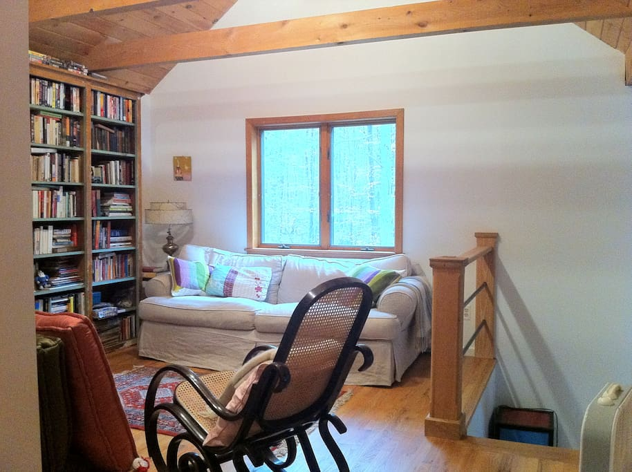 2nd floor loft with extra deep, comfy couch with books/movies galore and large TV.