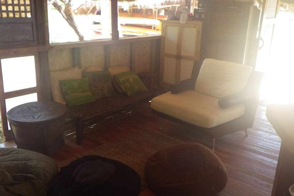 Guest lounge in house across river, bordering beach and inner lagoon