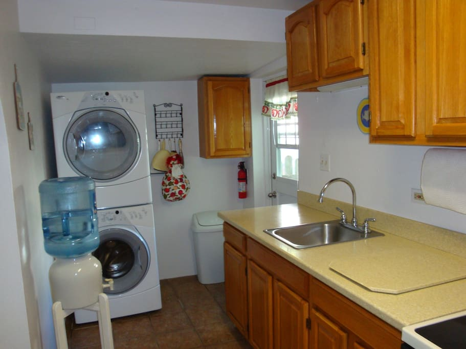 Washer & Dryer conveniently located in kitchen where you can dry those bathing suits for the next trip to the beach.