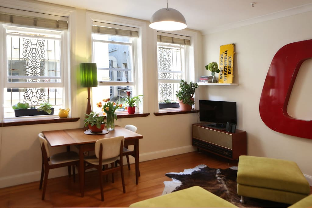 With three large windows, the living room is bright and bathed in natural light.