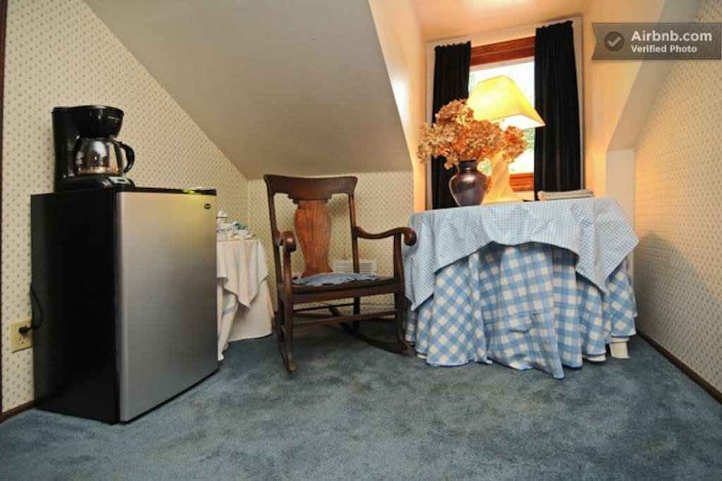 Dormer Room small refrigerator and table