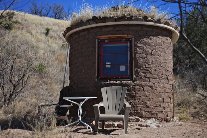 Tiny Round Adobe House at Deep Dirt Campus