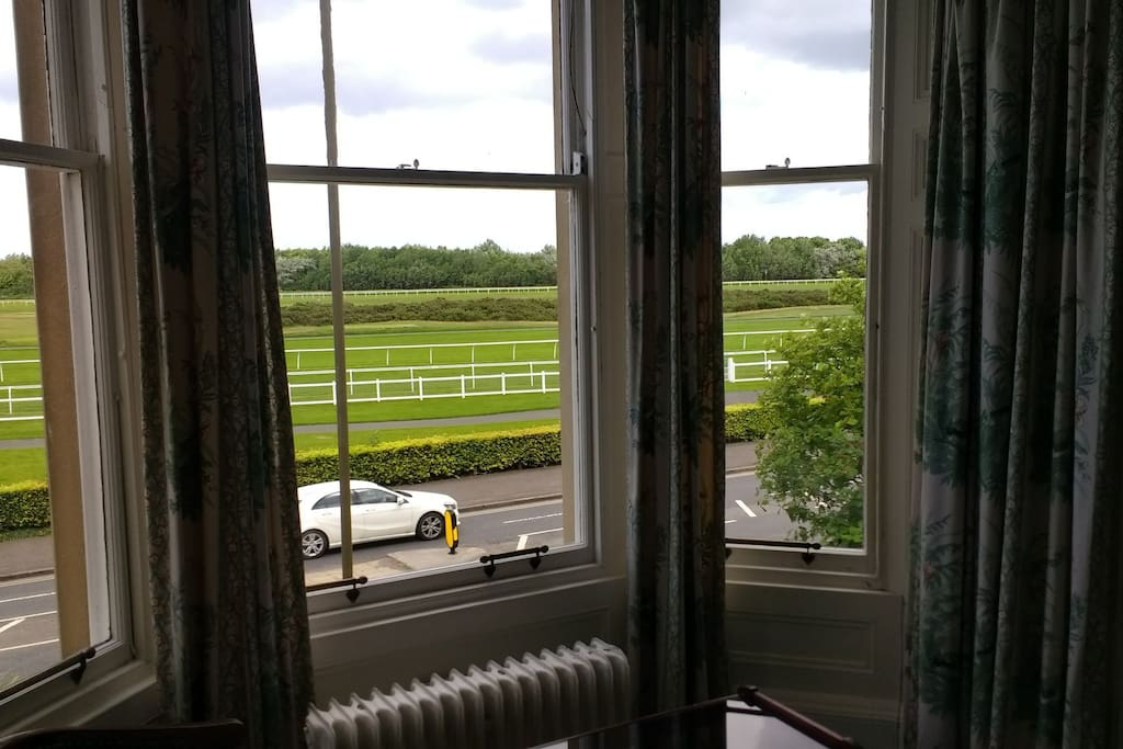 view over Musselburgh racecourse and golf course from bedroom window.